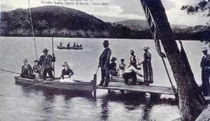Old fashioned picture of people on the dock and on boats on Lake Tonetta